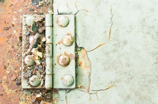 Hinge and Rust and Rivet on Old Light Green Metal Sheet of Car P