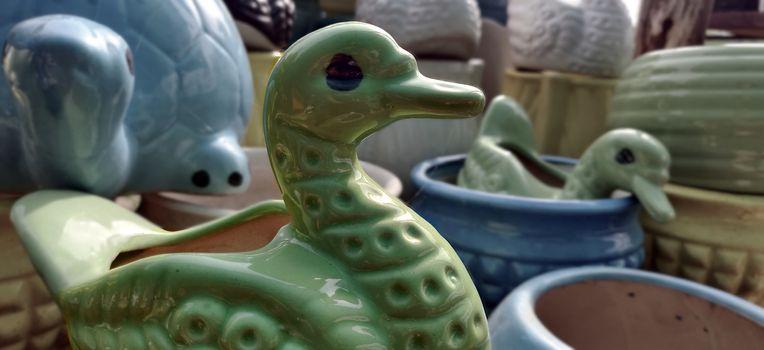 Green duck garden porcelain pot in a nursery for sale