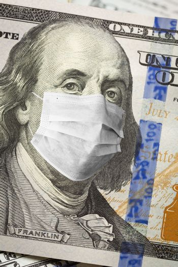 One Hundred Dollar Bill With Medical Face Mask on Face of Benjamin Franklin.