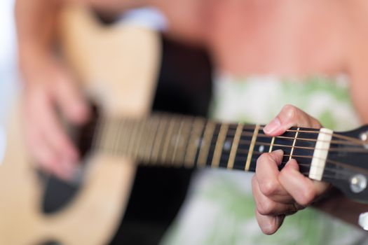 Woman Playing Ccoustic Guitar Abstract..