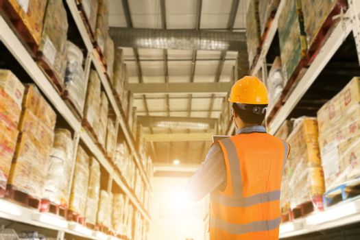 Manager in warehouse business check stock items wholesale industry logistic and export concept .