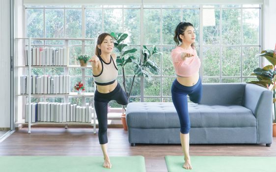 Balance the life of a young Asian woman attractive to exercise Stretching the yoga postures at home. sporty, wearing sportswear, training