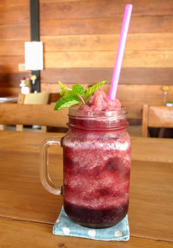 Smoothie berry in glass for a drink in a cafe.