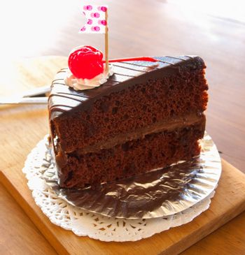 chocolate cake on wooden plate in cafe