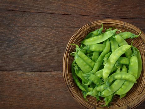 pea in basket on wooden table