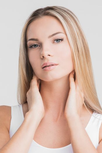 Beautiful blonde woman with long straight hair on a white background beauty skincare concept