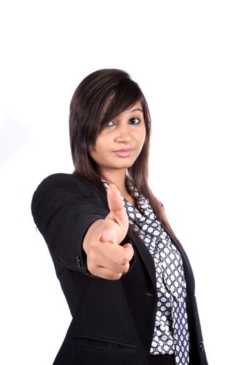 A metaphorical image of a young Indian businesswoman choosing an employee by pointing at the camera, on white studio background.