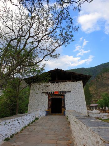 A bridge crossing the river to lead to the Rinpung Dzong in Paro, Bhutan