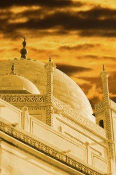 The minars of the Taj Mahal under the stormy cloudy skies.