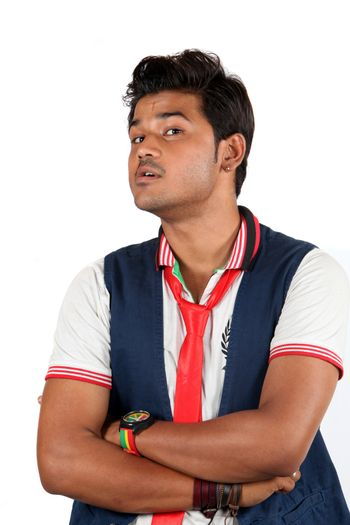 A young Indian guy wth questioning or doubting gesture, on white studio background.