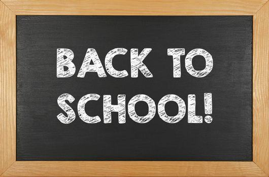 Back to school chalk handwritten sign over black chalkboard background with wooden frame and copy space