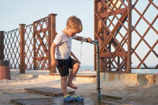Caucasian boy standing beach. Childhood summertime. Family vacation