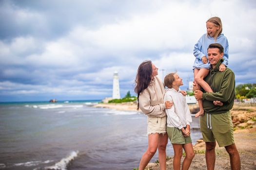 Family of four walk to the lighthouse