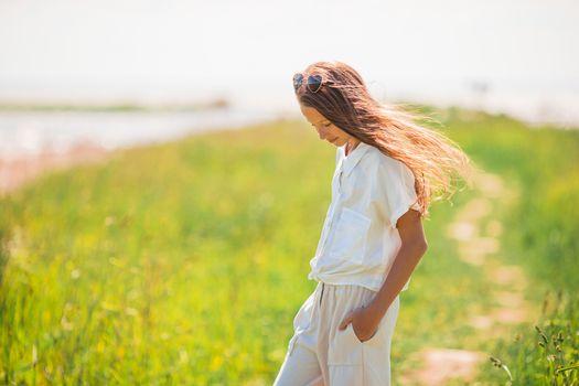Young beautiful girl having fun on the coast