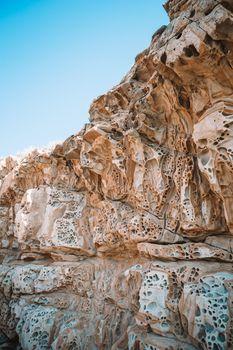 Cheese rocks from quartzite sandstone on Balck Sea in Crimea.