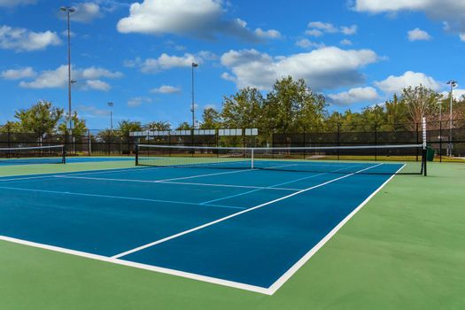 A Nice Green Tennis Court in a Local County Park