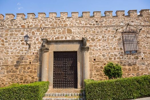 the medieval facade of the Palace de la Cava (16th century). Toledo, Spain