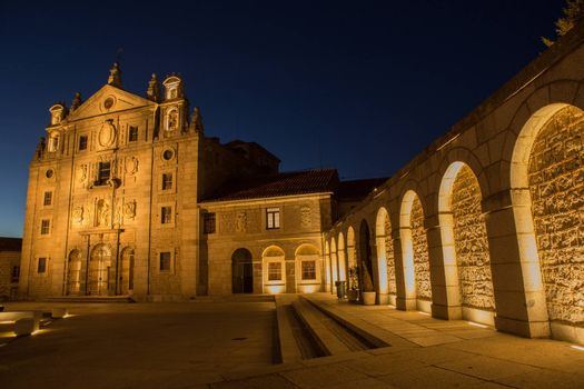 Night view of square in the front of Santa Teresa Convent in Avila, Spain
