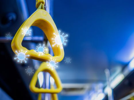 Close-up yellow handles in the shuttle bus with virus floating around with copy space. Virus infection spread disease concept.