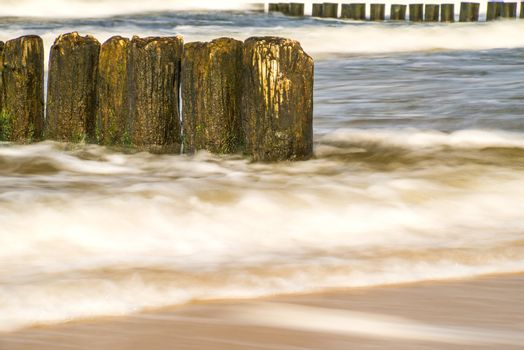Baltic Sea with groins and surf in longtime exposure
