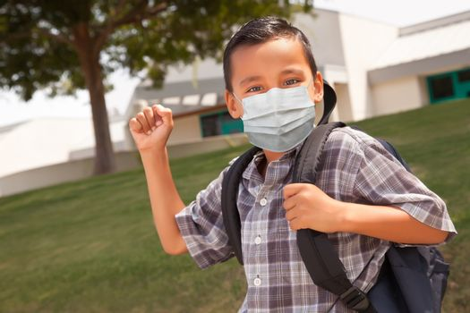 Hispanic Student Boy Wearing Face Mask with Backpack on School Campus.