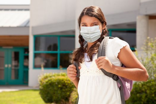 Hispanic Student Girl Wearing Face Mask with Backpack on School Campus.