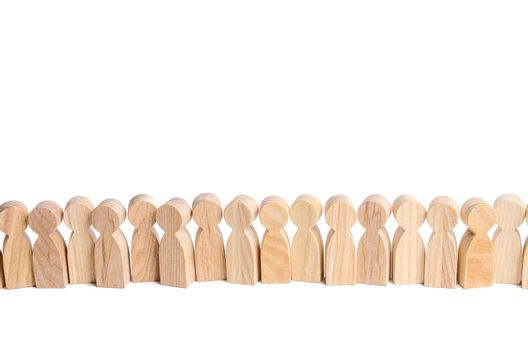 Wooden figures of people stand in a row. Waiting in line. Selection concept, choice. Search for new employees and workers, hiring for work. Group, crowd.