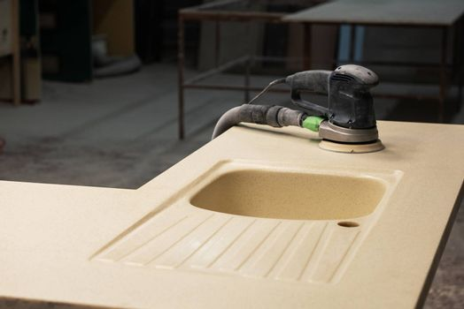 Stone sink furniture production. Grinder for polishing the surface of the sink