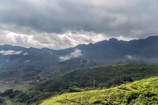 Smoky Mountains panoramic view to the green rice terraces highlands of Sapa District, Lao Cai Province, Vietnam. Sa Pa Asia.