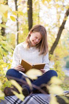 Reading girl laugh