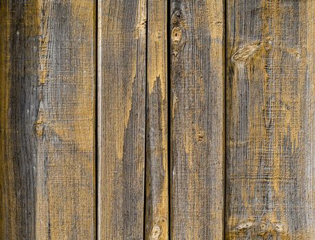 pattern old wooden planks with yellow paint close up