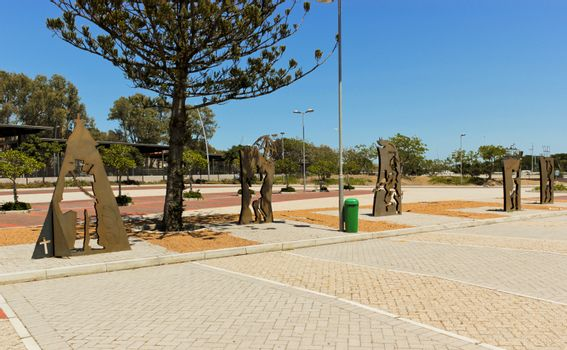 Parking lot at the Cape Town stadium with brown metal figures.