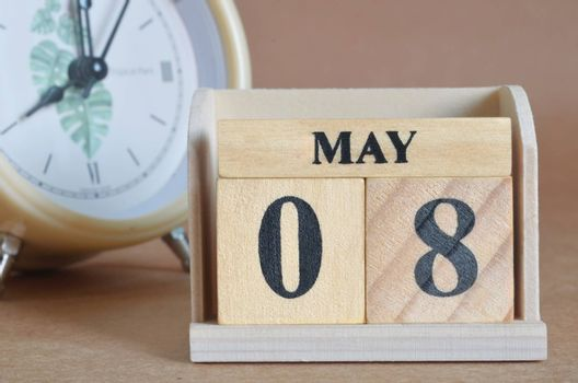 May 8, Cover design with clock in natural concept.