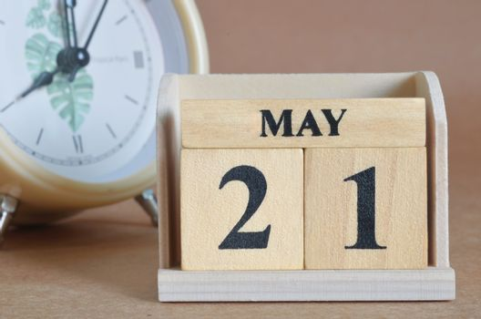 May 21, Cover design with clock in natural concept.