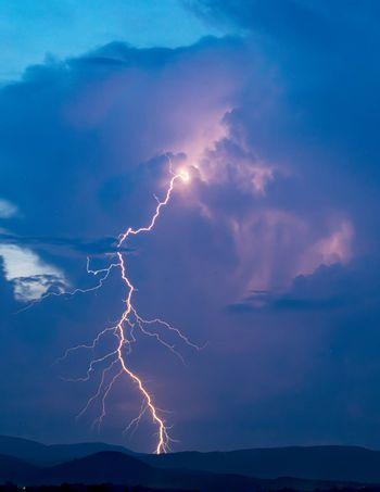 Color image of cloud-to-ground lightening over the Appalachian Mountains near Boone, NC.