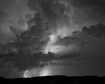 Monochrome view of multiple lightning strikes during summer thunderstorms in western North Carolina.