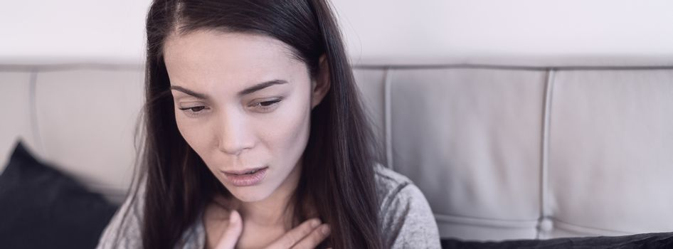 COVID-19 Corona virus sick woman with Coronavirus symptoms such as shortness of breath, tired, dizzyness, throat pain, breathing difficulties. Asian woman sick at home banner.