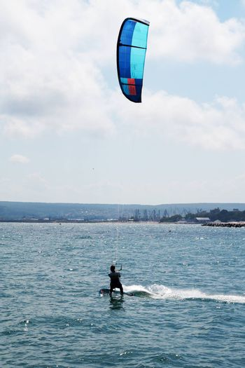 Varna, Bulgaria - July, 19, 2020: a man is kiting the sea against the background of the beach