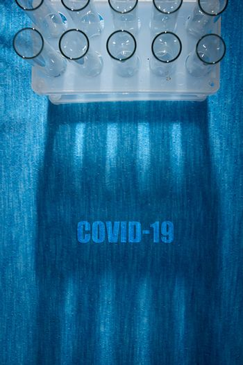 Laboratory test tube poster and test tube shadow - covid-19 virus