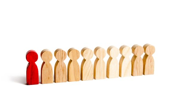 A red man stands with people in a row on a white background. The concept of exceptional and talented employee. Selection, recruitment of employees and employees. Statistics. Spy in among the staff.