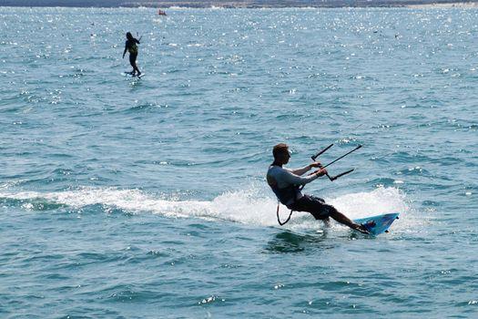 Varna, Bulgaria - July, 19, 2020 men is kiting the sea
