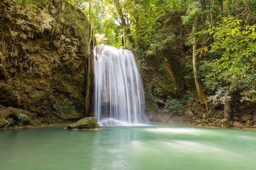 Long exposure short of Erawan waterfalll, a beautiful tropical waterfall in Thailland