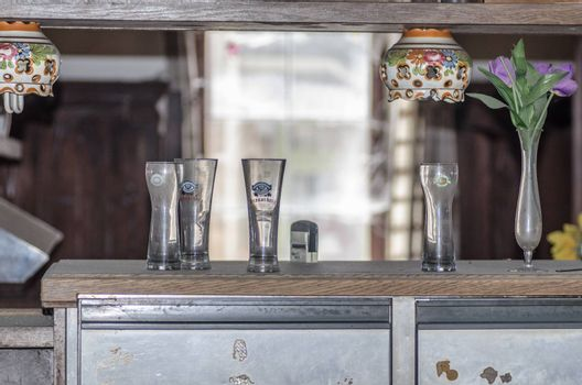 Glasses on a bar of abandoned restaurant