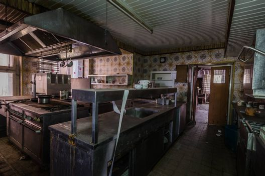 dark kitchen in abandoned old guest house