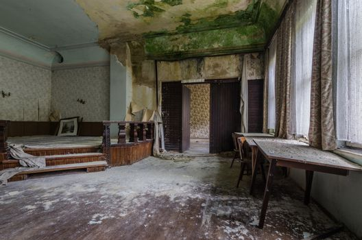 stage with green mold in a old guest house