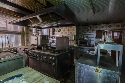 Old devices in a kitchen of an abandoned hotel