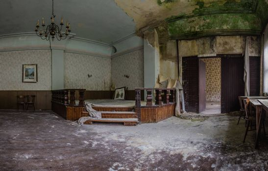 stage with green mold in abandoned inn