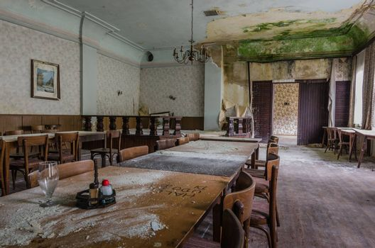 tables in a ballroom with mold in old inn