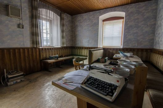Typewriter in lounge of a abandoned guest house