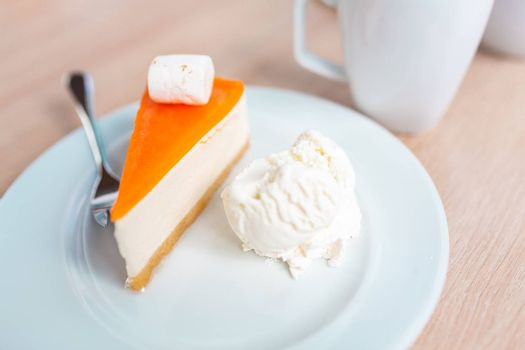 A piece of delicious original cheesecake served with ice cream